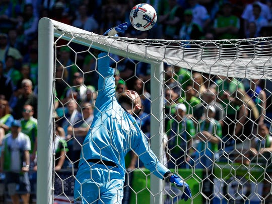 Seattle Sounders goalkeeper Stefan Frei leaps to knock a ball over the cross bar during the first half of an MLS soccer match against the Portland Timbers, Saturday, May 27, 2017, in Seattle.