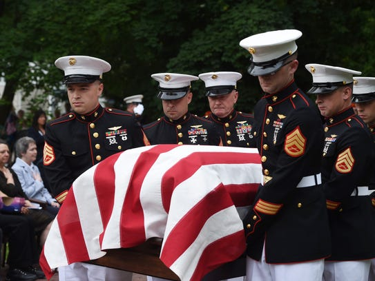 Members of the U.S. Marine Corps carry the casket of