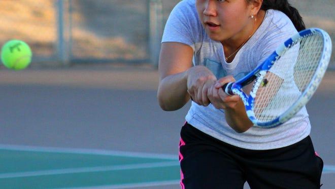 Alamogordo's Melanie Jun eyes a tennis ball during practice Wednesday evening at the Oregon Courts.