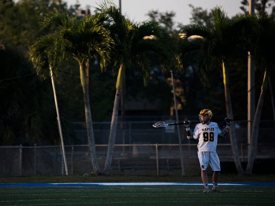 Naples' Blake Novak looks up at the scoreboard after Barron Collier scores another goal during the District 20 high school boys lacrosse championship at Barron Collier High School on Thursday, April 19, 2018.