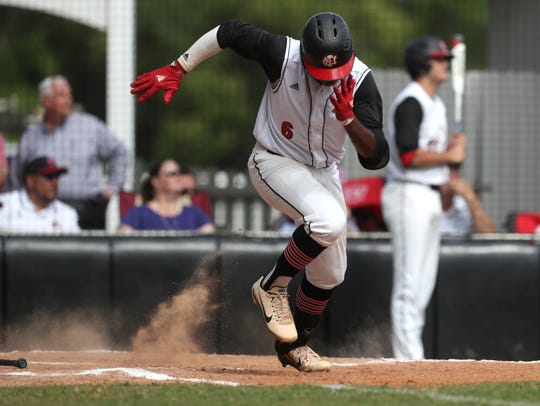 NFC's Brandon Walker takes off for first base against