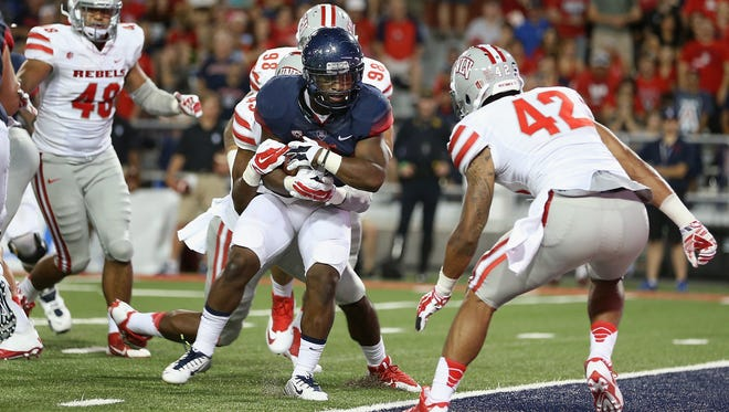Arizona running back Terris Jones-Grigsby scores on a 2-yard run against UNLV during the third quarter of their game Aug. 29 in Tucson, Ariz. Jones-Grigsby averaged 9.5 yards per carry in a 58-13 Arizona win.