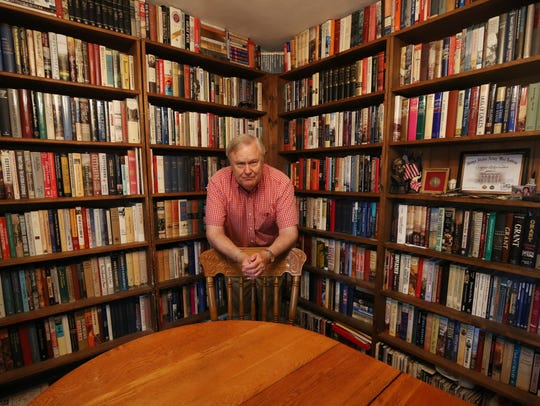 Graham Weaver has over 9,000 books in his home. The