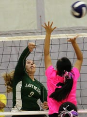 Cloudcroft's Britney Hickman fires a ball past a Mescalero