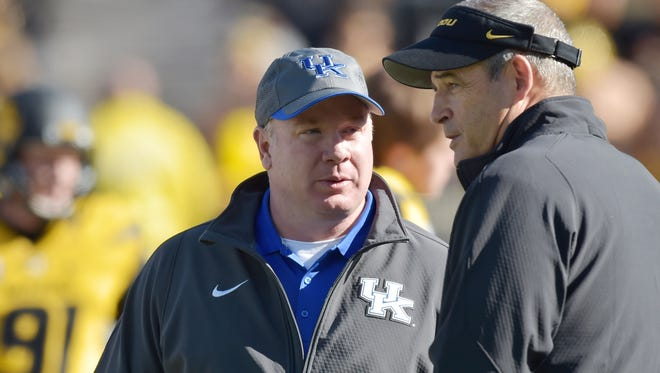 Kentucky head coach Mark Stoops (left) talks with Missouri head coach Gary Pinkel before Saturday's game.