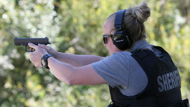 Investigator Lesley Daniel shoots during a malfunction drill Tuesday at the Tennessee Sports Foundation shooting range in Jackson.
