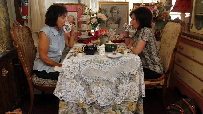 Susan Parisi, left, and Maureen DiNardo of Fairfield are regulars at Sally Lunn's Tea Room and Restaurant. The two meet every Wednesday at one of the tables and sip tea.