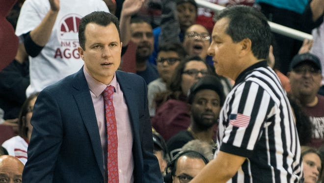 New Mexico basketball coach Paul Wier gets hit with a technical foul late in the second half during his first trip back to the Pan American Center.