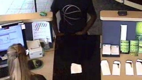 Video still from the Aug. 12 robbery at Vibe Credit Union in South Lyon.