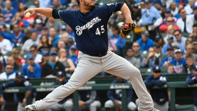 Milwaukee Brewers starting pitcher Jhoulys Chacin (45) delivers during the first inning of a tiebreaker baseball game against the Chicago Cubs on Monday, Oct. 1, 2018, in Chicago. (AP Photo/Matt Marton)