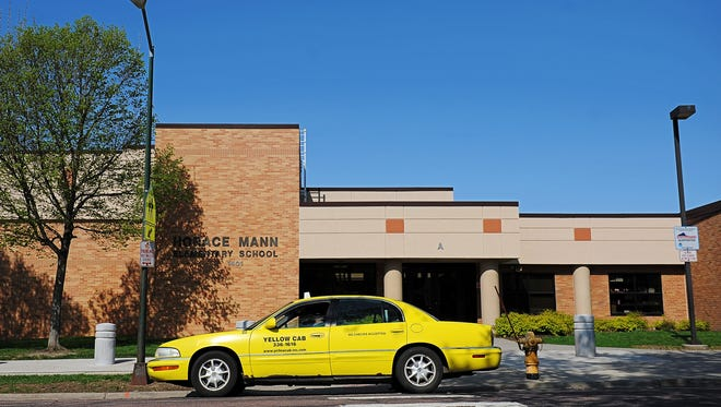 A Yellow Cab taxi sits outside Horace Mann Elementary School after dropping a child off Thursday, May 5, 2016, in Sioux Falls.