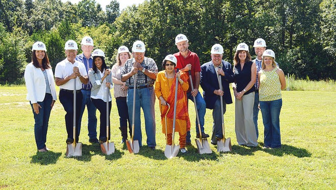 On hand to break ground for Mountain Home Christian Academy's new high school facility were board members, administrators and the builder. They include: from left, Robin Robinson, Ray Sherry, Forrest Cotter, Lori Mathis, Angie Strom, Bob Mathis, Ashraf Mathis, Mike Bauerlein, Wayne Camp, Melissa Bauerlein, Joey Peglar and Jinger Wright.