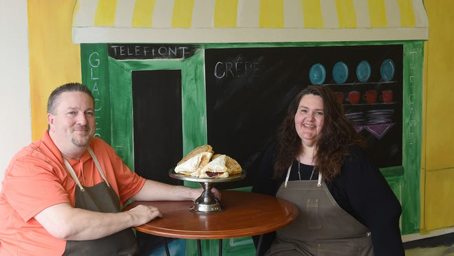 Brian and Susie Van Ness open the French-inspired Susie's Bistro and Bakery in downtown Newark. The couple sits in front a mural painted by local artist Lori Clark.