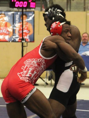 Holmes senior Kyrie Glover wrestles in his second round match at 152 pound Friday at the KHSAA state championships.