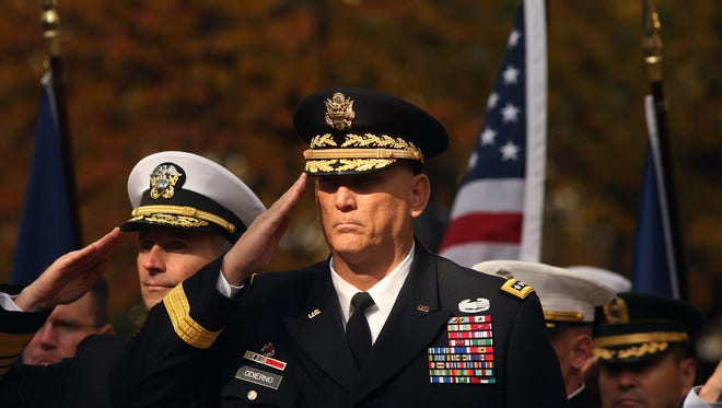 Army Gen. Raymond T. Odierno salutes during the playing of taps before the start of the Veterans Day Parade Friday in New York. BOB KARP/STAFF PHOTOGRAPHER New York City,  11/11/11--US Army General Raymond T. Odierno salutes during the playing of Taps during opening ceremonies before the start of the 92nd Annual Veterans Day Parade.  STAFF PHOTOGRAPHER/BOB KARP-Daily Record 2011