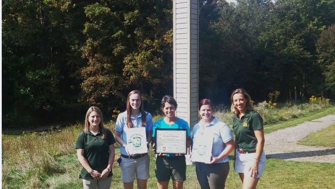 Presenting the WILD School Sites award, from left, are Meredith Gilbert, ODNR Division of Wildlife; Emily Smith, OBS; Gail Laux, OBS; Julie Swartz, OBS; Jamey Emmert, ODNR Division of Wildlife.