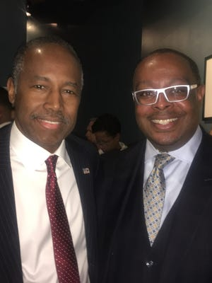 Dr. Ben Carson, left, and Tony Baltimore met last week in Detroit to discuss public housing issues. Carson, a Detroit native, is the U.S. Department of Housing and Urban Development's new director. Baltimore is the Lansing Housing Commission's board chair.  The housing commission receives funding from HUD.