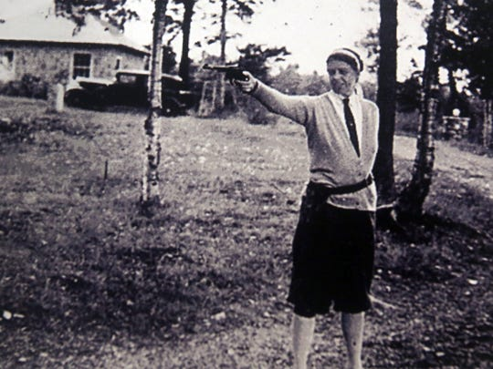 A photograph taken in 1957 of Eleanor Roosevelt firing a pistol at the Roosevelt estate at Hyde Park after receiving her pistol permit. The photo is part of the collection of historical memorabilia and artifacts on display at the Dutchess County Sheriff's Office County Sheriff's Office headquarters in Poughkeepsie. The Sheriff's Office is celebrating its 300th anniversary.