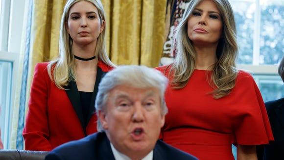 Ivanka Trump, left, and first lady Melania Trump listen