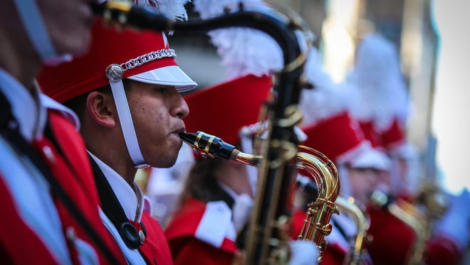 Naples High senior Luis Nicacio, 18, marches in the 91st annual Macy's Thanksgiving Day Parade with the Great American Marching Band in New York City on Thursday, Nov. 23, 2017.