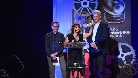Robin Bylenga accepts Pedal Chic's award for most women-friendly bike shop at the Interbike Awards.