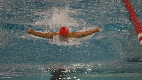 Lucas Reisch competes in the 100-meter butterfly. He is a member of the Fairport Area Swim Team.