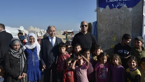 Secretary of the Department of Homeland Security Jeh Johnson poses in March for a photo with Syrian refugees in Turkey.