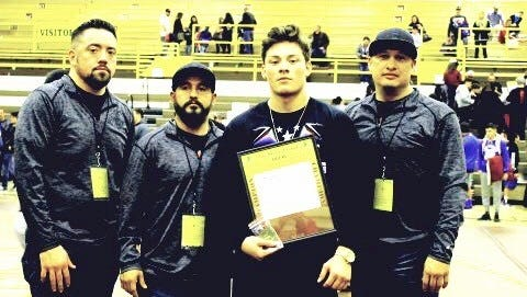 From left, Cobre head coach Johnny Gallegos, assistant coach Richard Marquez, wrestler Isaiah Sifuentes, and assistant coach Reyne Maynes