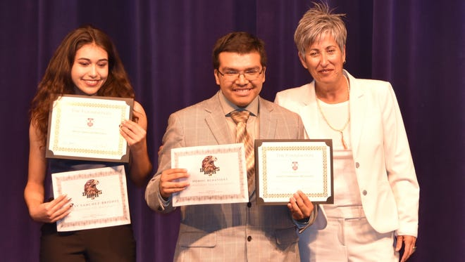 Ellen Goodman, executive director of the Foundation for the Palm Springs Unified School District (right), congratulates scholarship winners Betsy Sanchez-Briones and Henoc Benavides.