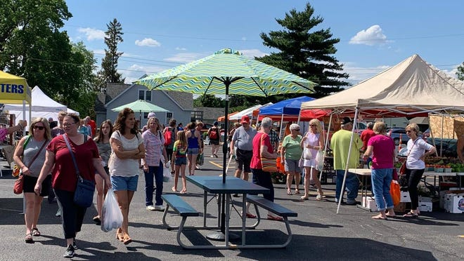 There won't be any picnic tables -- at least through June -- at the Morton Farmers Market 'N More. This photo was taken at a market day in 2019.