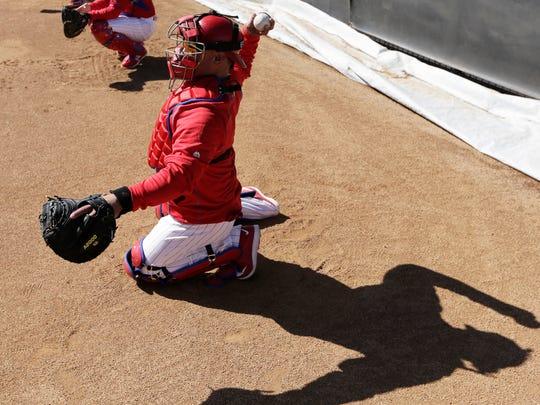 Philadelphia Phillies catcher Carlos Ruiz throws during