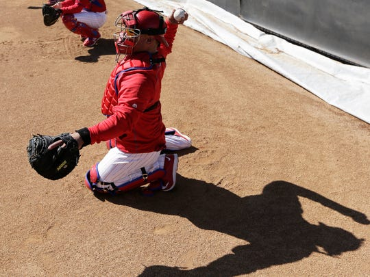 Philadelphia Phillies catcher Carlos Ruiz throws during