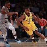 Freshman Xavier Simpson, Michigan hoops entering up-tempo week