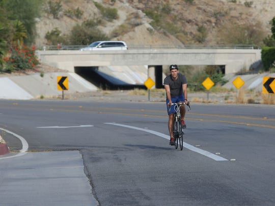 A cyclist rides on the path of what will become the CV Link on Parkview Drive in Palm Desert. Construction on the city's 5-mile portion of CV Link is slated to start in early 2020, but could be delayed if project funding from Desert Healthcare District is lost, officials say.