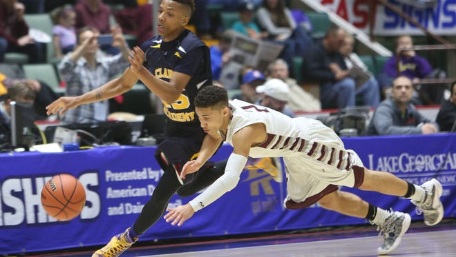 From left, Clark Academy's Andrew Carthon (25) and Oriskany's Marcus Smithing (2) battle for a loose ball during the boys Class D semifinal at the Glens Falls Civic Center March 11, 2016. Oriskany won the game 59-40.