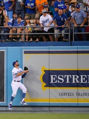 Los Angeles Dodgers center fielder Chris Taylor watches