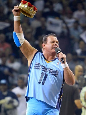 "In this April 23, 2011, file photo, professional wrestler Jerry ""The King"" Lawler gestures to fans before the start of Game 3 of a first-round NBA basketball series between the Memphis Grizzlies and the San Antonio Spurs, in Memphis. Police in Tennessee say Lawler and his girlfriend have been arrested on charges of domestic violence after responding to a call at Lawler's home Thursday night in East Memphis."