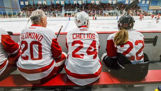 Local skater Marissa Weber takes in the action alongside former Red Wings players Mickey Redmond and Chris Chelios during the Chicago Blackhawks and Detroit Red Wings alumni game at the Mullett Center in Hartland on Saturday, Nov. 5, 2016. Several local skaters were given the opportunity to skate with the legendary players.