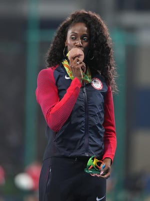 Ashley Spencer (USA) with her bronze medal after the women's 400m hurdles final in the Rio 2016 Summer Olympic Games at Estadio Olimpico Joao Havelange.