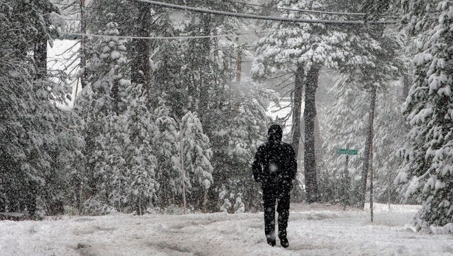 A Oct. 17, 2016, file photo shows snow blanketing an area near Serene Lakes in Soda Springs, Calif.  The first major winter storms of the season are forecast to dump snow in the north-central and Northeast U.S.