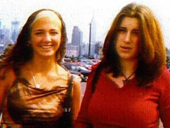 This 2002 photo shows Alicia Cook (left) and her cousin
