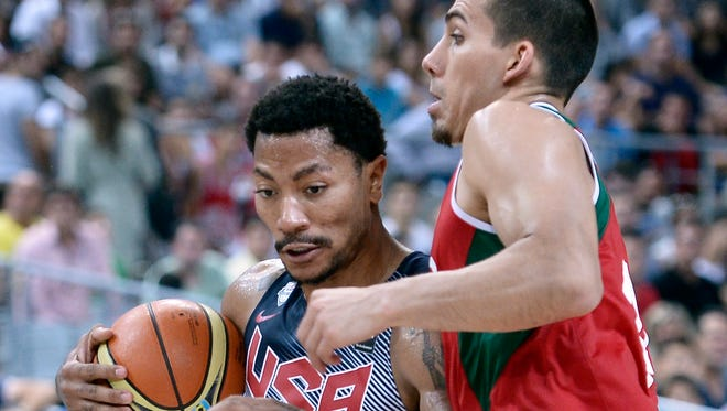 Derrick Rose drives against Mexico's Paul Stoll in Saturday's Round of 16 game at the FIBA World Cup. Rose struggled from the field vs. Mexico.
