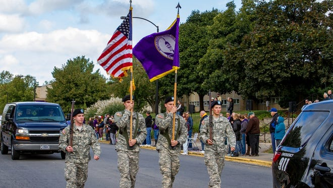 UW-Stevens Point ROTC cadets march in the university's Homecoming parade.