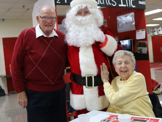 Merle and Marty Ahrens are greeted by Santa Claus,