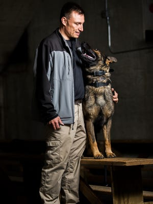 Broome County Sheriff's Deputy Will Andres and his K-9 partner Alan pose for a portrait while training for narcotics detection at the Floyd L. Maines Memorial Arena in Binghamton.