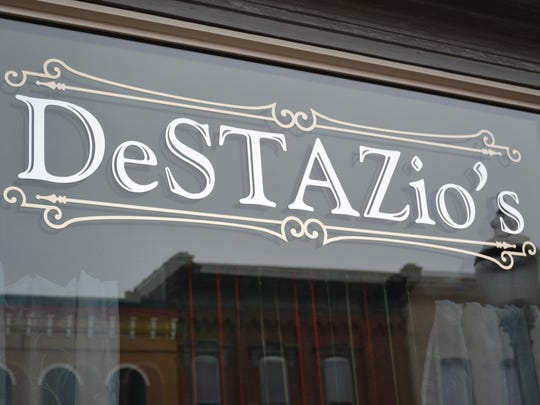 "DeSTAZio's pizza shop opened in Elmore on December 29. The shop's name gives homage to both Mike DeStazio's family history and the nickname, ""Staz"", he goes by when coaching Genoa girls basketball."