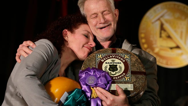 Third-place winner Marieke Penterman of Holland's Family Cheese in Thorp, congratulates Mike Matucheski, Antigo-based Sartori Co. master cheesemaker, who took home top honors for his Sartori Reserve Black Pepper BellaVitano cheese March 9, 2017 at the U.S. Championship Cheese Contest held in Green Bay, Wisconsin.