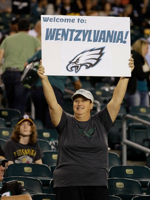 A Philadelphia Eagles' fan holds up a sign in support of quarterback Carson Wentz during the second half of Sunday's game vs. Pittsburgh. The Eagles won the game 34-3 to improve to 3-0.
