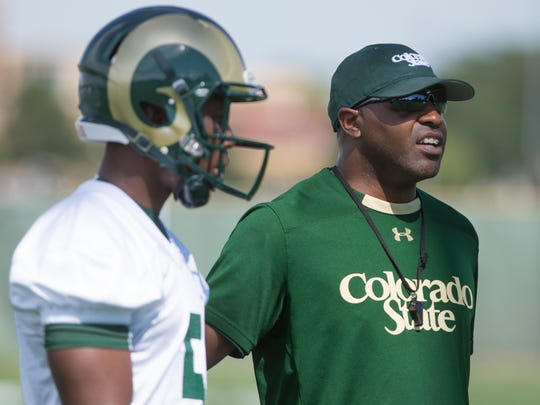 CSU cornerbacks coach Terry Fair instructs players during the first practice of the season Friday, August 7, 2015.