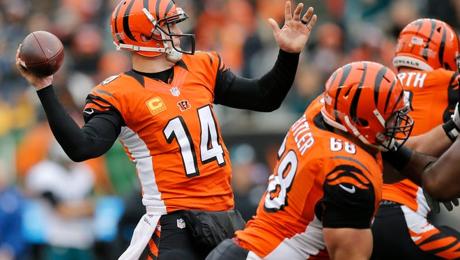 Cincinnati Bengals quarterback Andy Dalton (14) throws for the end zone in the second quarter of the NFL Week 13 game between the Cincinnati Bengals and the Philadelphia Eagles at Paul Brown Stadium in downtown Cincinnati on Sunday, Dec. 4, 2016.
